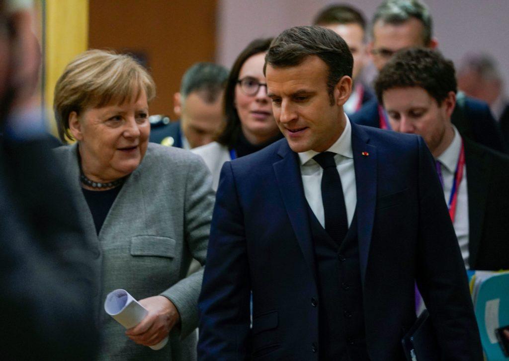 Thủ tướng Đức Angela Markel và Tổng thống Pháp Emmanuel Macron. Ảnh: AFP.