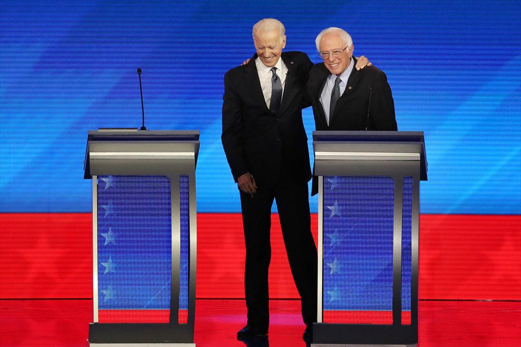 Joe Biden và Bernie Sanders trong một cuộc tranh luận trên truyền hình. Ảnh: Getty Images.