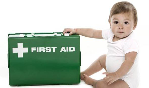 Baby holding first aid kit