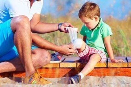 Parent giving child first aid