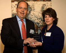 Lou Grossman, APR, accepts the Anthony Fulginiti Education Award from Maribeth Roman Schmidt at the 2009 PRSA/Philadelphia Pepperpot Awards