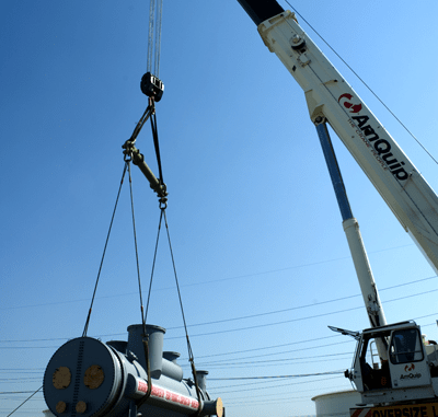 A 115,000 pound heat exchanger is lifted off a flatbed truck at Delaware City Refinery.