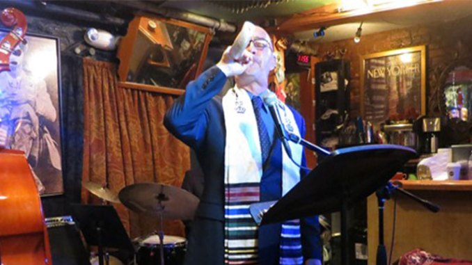 Rabbi Blane blowing the shofar at Jazz High Holy Days service on Rosh Hashana 2012