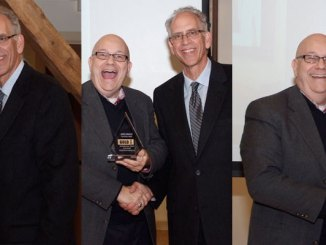 Steve Lubetkin, LMC managing partner, accepting the company's four 2014 ASTRA Awards from NJCAMA president Larry Trink. -- Frank Peluso photos.