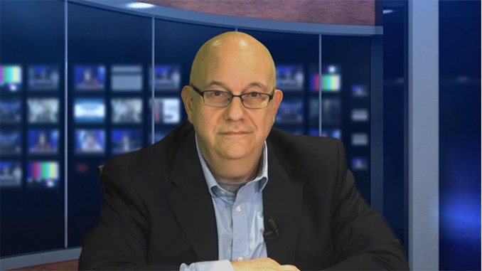"""Steve Lubetkin in Lubetkin Media Companies news studio, participating in Ken Countess' """"Market Your Business Like a Pro"""" video podcast."""
