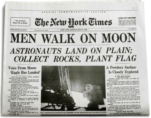 man walks on moon newspaper