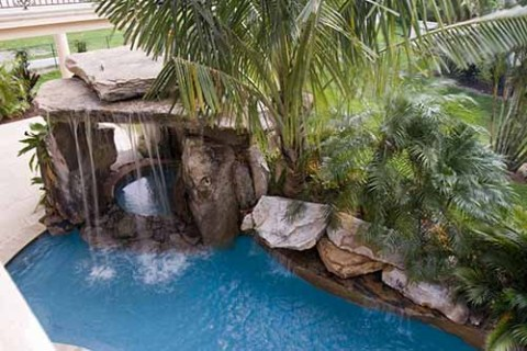Lagoon Pool with Tall Grotto and Natural Stone Waterfall
