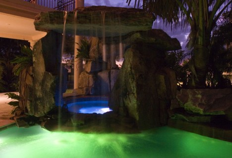 Lagoon Pool with Tall Grotto and Natural Stone Waterfall Swimming Pool Underwater Lighting