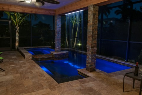 View from the house to the modern pool and rain curtain