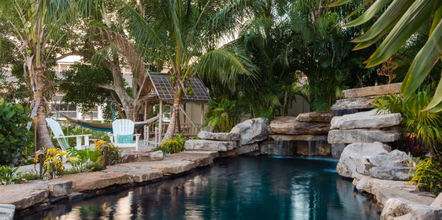 Grotto, seating, Tiki Hut and Hammock swinging in Coconut Palms