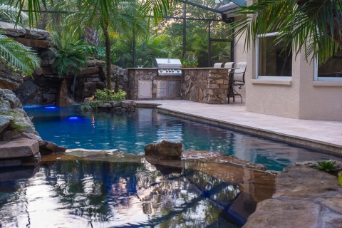 Spa overlooking pool to the outdoor kitchen