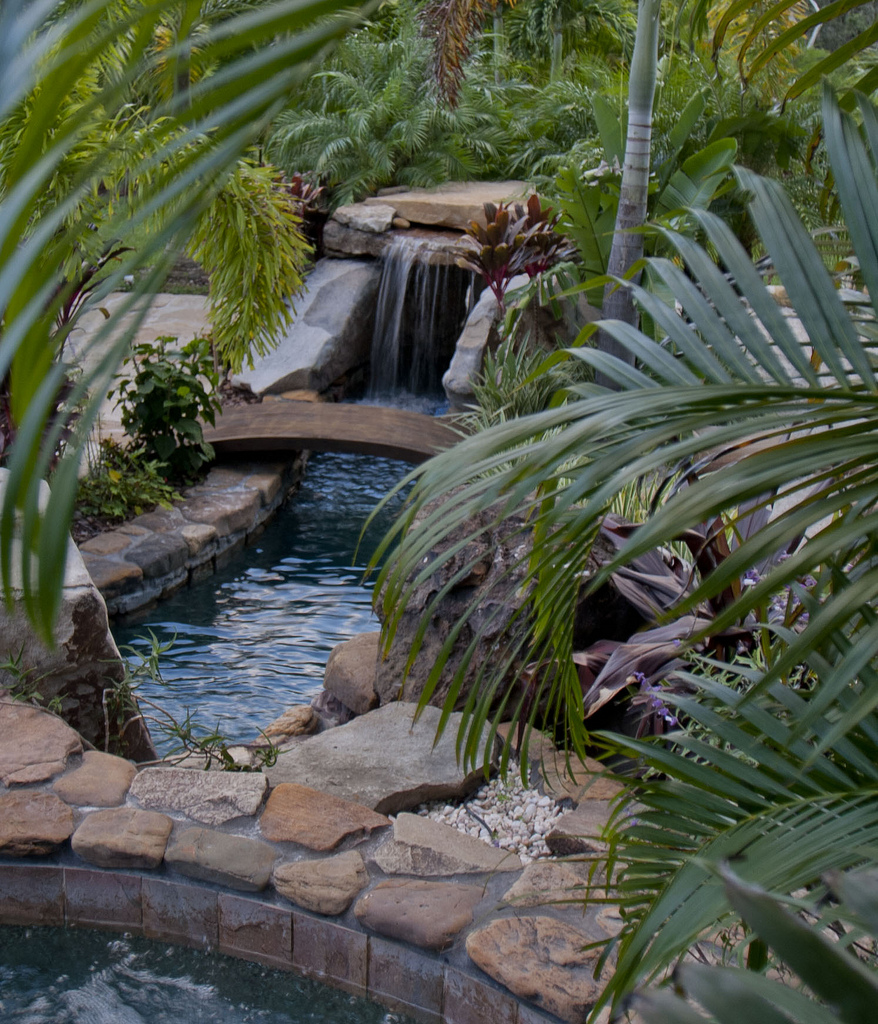 natural stone grotto waterfall with elevated spa lucas lagoons