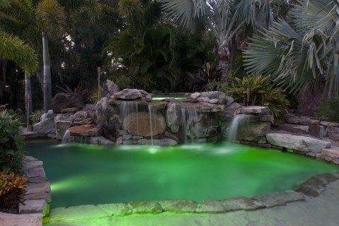 Natural Stone Grotto Waterfall with Elevated Spa Swimming Pool with Underwater Lighting