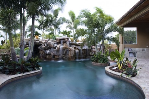 Shallow sundeck and lagoon pool with island planters
