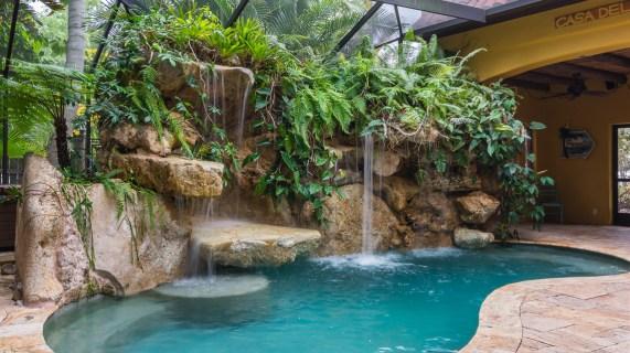 Cascading rock waterfall pool Siesta Key lagoon pool