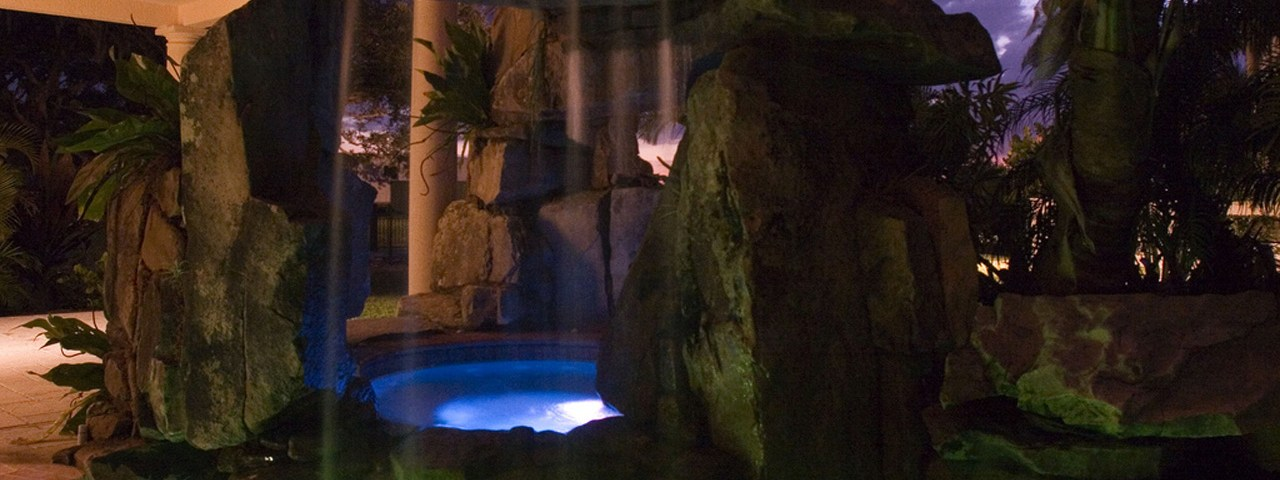 Siesta Key Swimming Pool with Tall Grotto Waterfal and Underwater Lighting