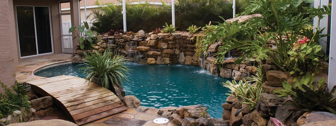 lucas lagoons pool remodel with wooden bridge stream view lagoon-pool