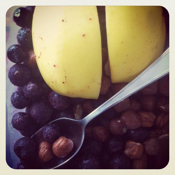 Frugal breakfast: apple, frozen blueberries & filberts