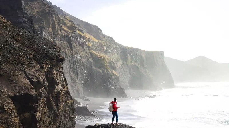 man standing on mountain in iceland in the pursuit of life
