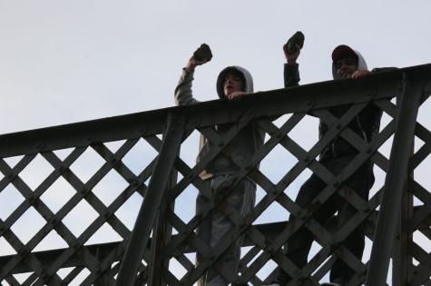 Kids throwing bricks from a bridge