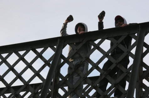 Kids throwing bricks from a bridge