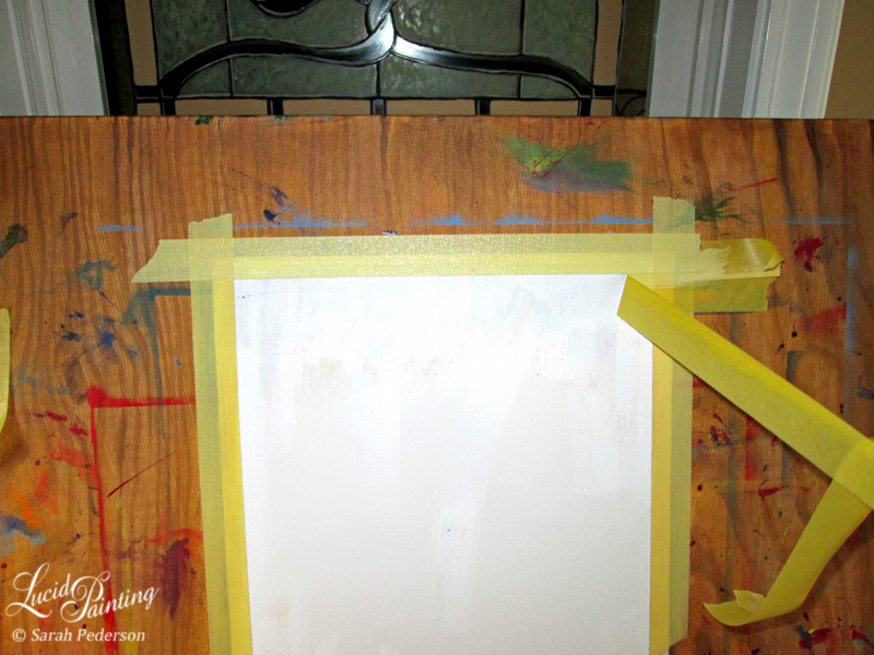 Artist is removing one piece of horizontal tape along the top edge of the faux paper.