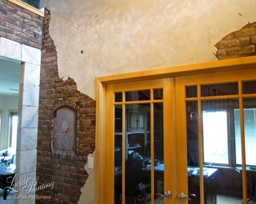 Faux stone column with cracking plaster and trompe l'oeil brick wall.