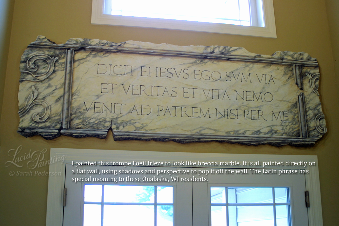 I painted this trompe l'oeil frieze to look like breccia marble. It is painted directly on a flat wall but the use of shadows and perspective makes it look like it is attached to the wall. The marble appears to be aged and crumbling, and is inscribed with a phrase in Latin.