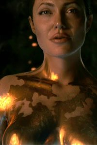 Angelina Jolie as Mother, the nude gold-painted dragon woman.