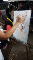 Première touche de couleur sur la peinture en mouvement sur la danseuse réalisée aux rencontres de Maubourguet 2017 où art et sport se côtoient par Lucie LLONG, artiste peintre du mouvement