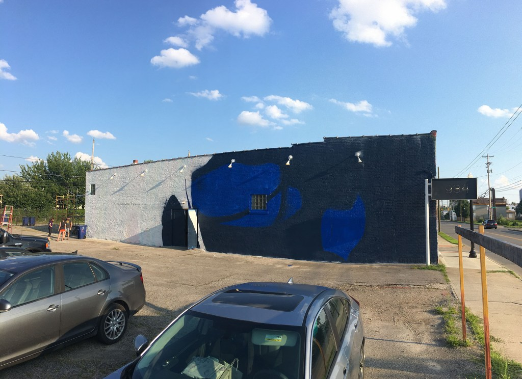 Progress shot of the mural. First colors have been laid down.