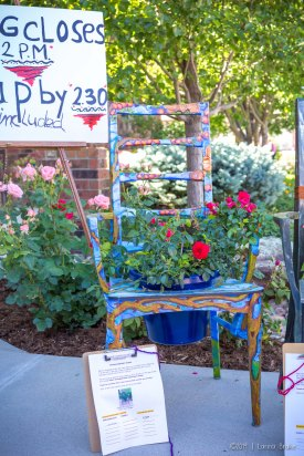 Silent auction of beautifully painted garden chairs.