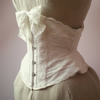 d912aaae5 Ribbon cincher with vintage eyelet lace by Snowblack Corsets (Poland).  Price starts at €220 (around  240 USD).