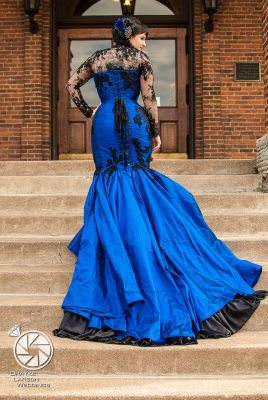 KMKDesigns Located in MN, can make custom corset dresses to order in many styles, this mermaid style corset dress is made from blue silk with hand stitched lace and rhinestones.