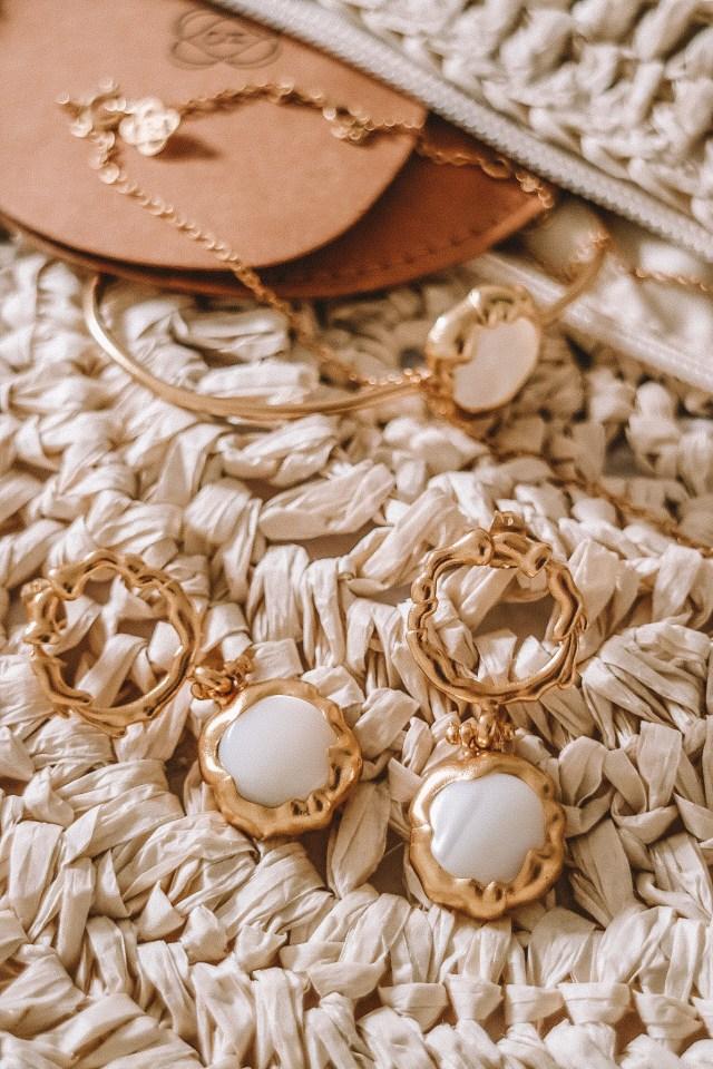 The jewellery sitting on a raffia bag