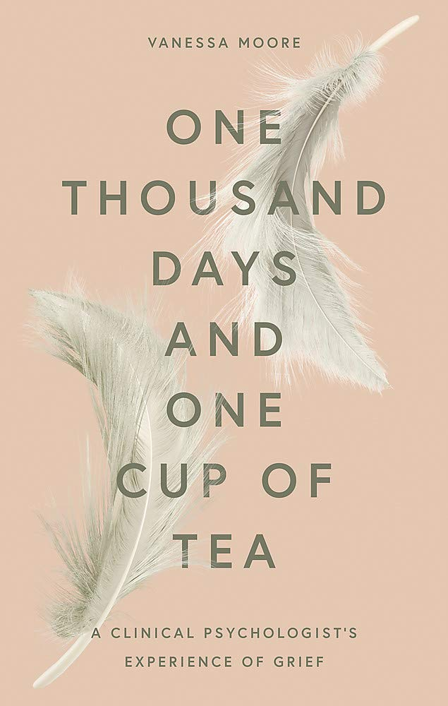 one thousand days and one cup of tea cover with two white feathers, centered black text and pale pink background.