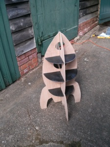 Four rocket shapes cut, and shelves checked again. The whole lot was then spray painted black.
