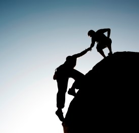 Coaching - climber helping another up