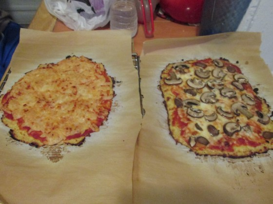 Cauliflower pizzas: dairy free cheese on the left, mozzarella and mushrooms on the right