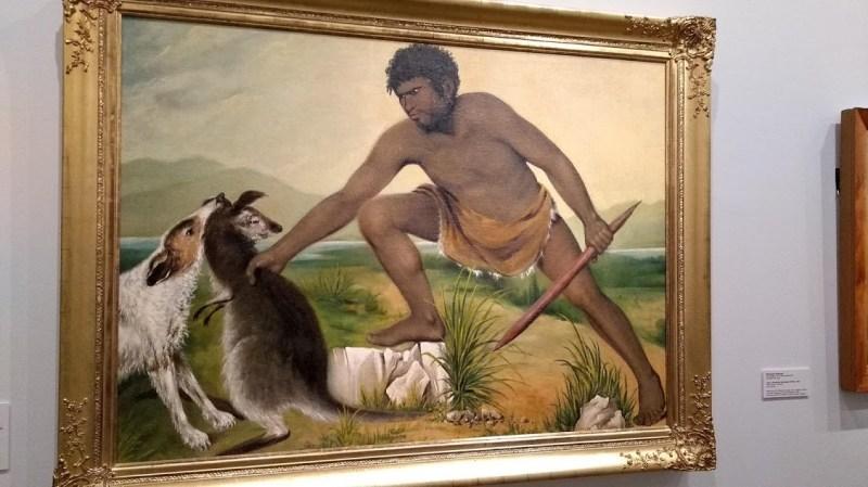 Dipinto di un aborigeno australiano e un canguro o wallaby
