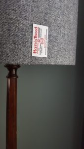 A large floor lamp sporting a My tall floor lamp sporting a 45cm Plain Twill Mid Grey Harris Tweed lampshade