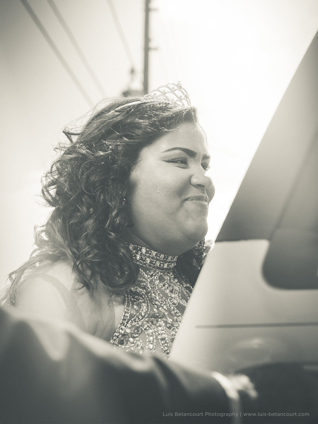 black and white quinceanera photography entering limousine smiling luis betancourt photography
