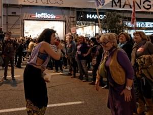 La voz de las manifestaciones feministas en Madrid al megáfono. Día de la Mujer en Madrid. Manifestación contra la Ley del aborto de Gallardón (Partido Popular). By Luis F. Roncero