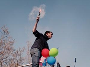 """Manifestante con bengala. """"Marchas de la Dignidad"""" en Madrid. Manifestación contra el paro, la precariedad y los recortes del Partido Popular. By Luis F. Roncero"""