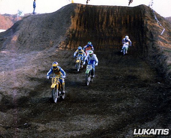 Carlo Coen leads a pack of 125 two-strokes