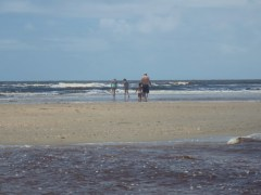 With the kids on a sandbar at low tide