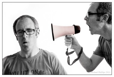 man yelling through a megaphone