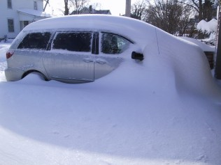 van buried in a snow drift