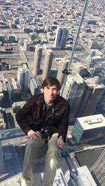 Sitting in a glass box at the top of the second tallest building in the Western Hemisphere.