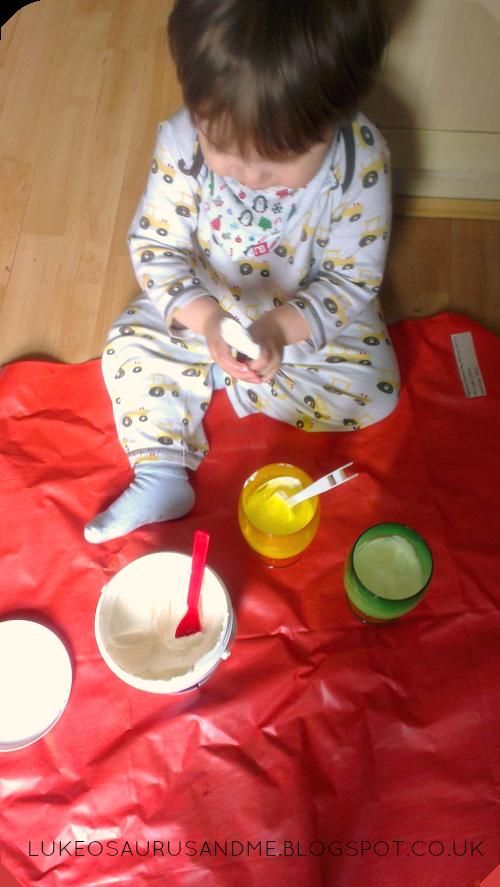 Luke mixing up frozen yoghurt drops for Easter from lukeosaurusandme.co.uk